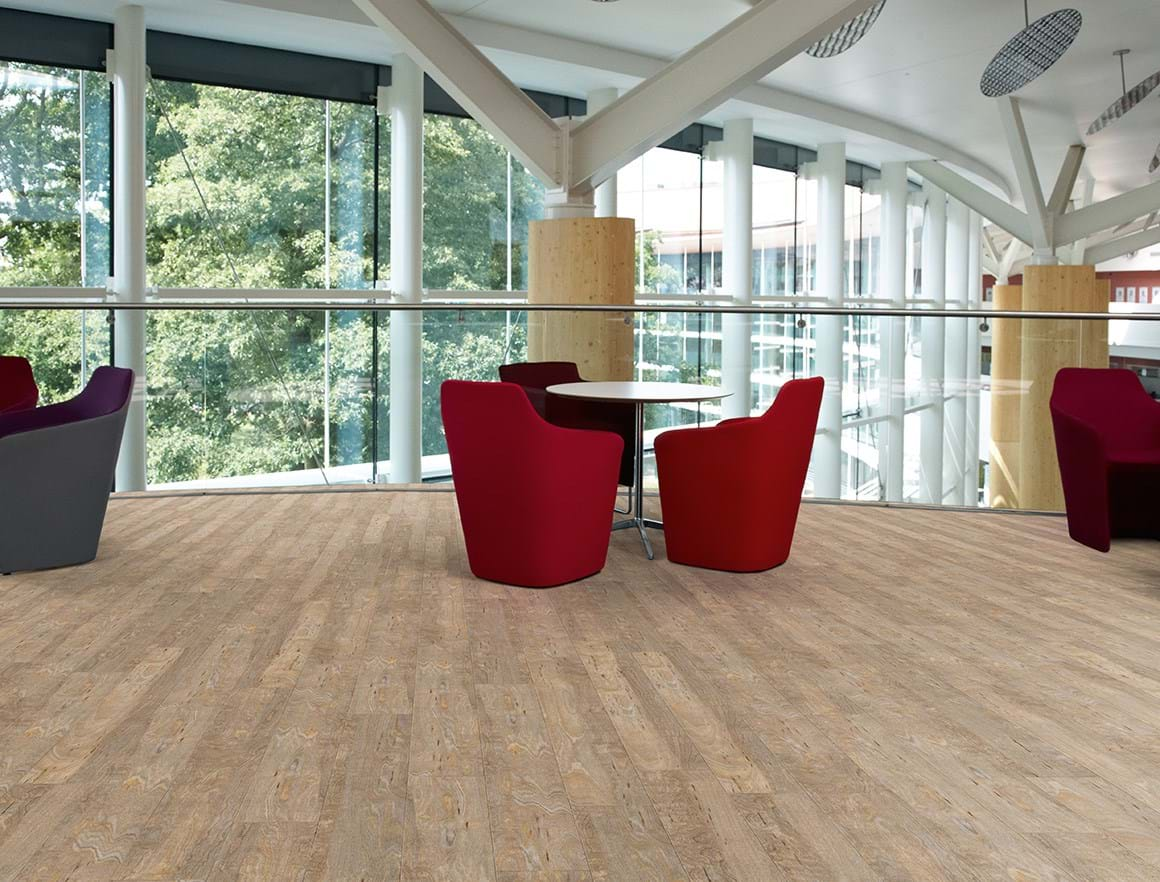 Amtico First LVT in Bleached Elm (SF3W2516) laid in a Stripwood pattern
