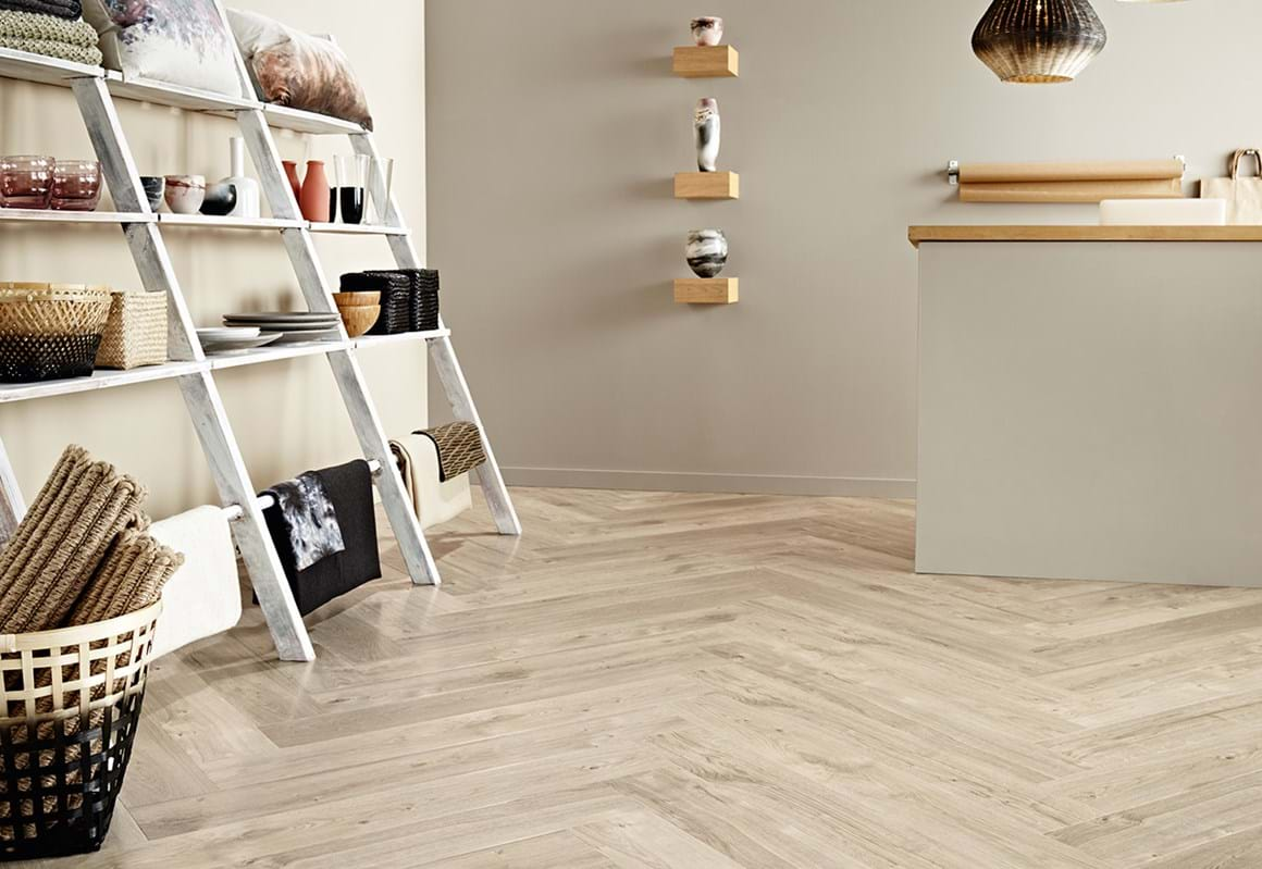 Amtico Access looselay LVT in Sun Bleached Oak (SX5W2531) laid in a herringbone format