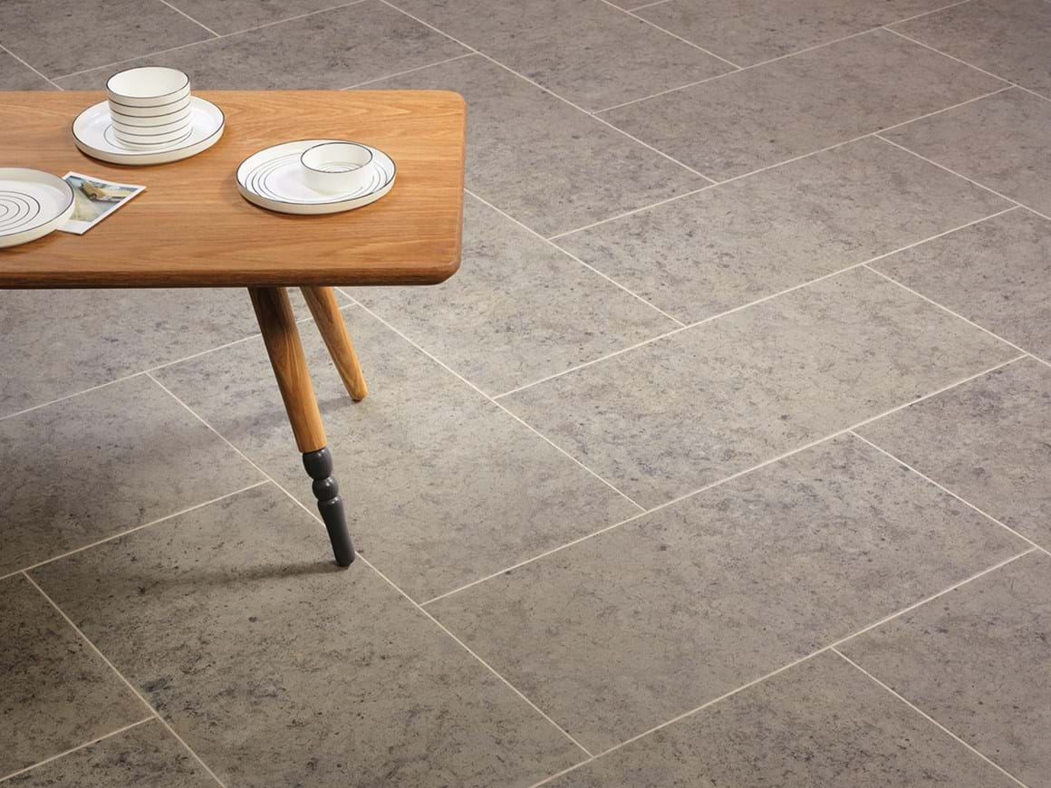 Buckland Stone in Herringbone Tile Laying Pattern with Riverstone Tundra Stripping